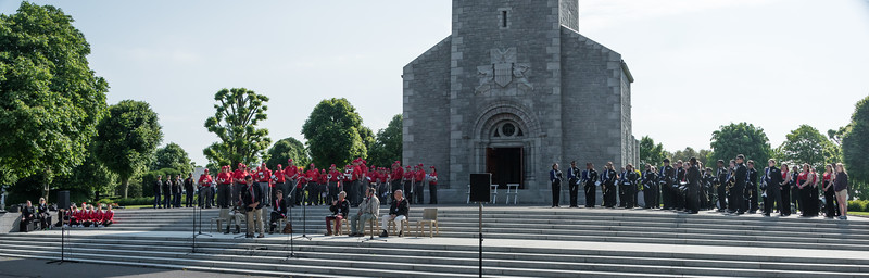 The program was held on the Memorial Chapel terrace, overlooking the cemetery.  Three musical groups participated.