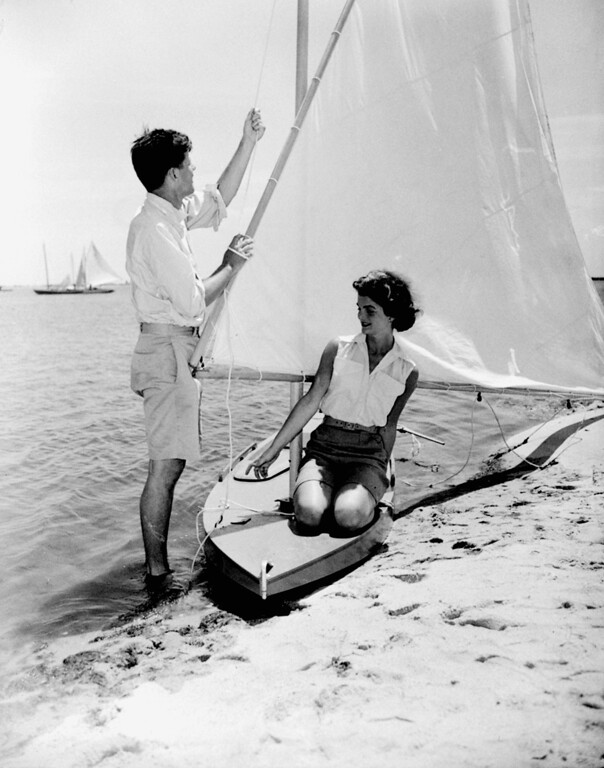 """. In this June 27, 1953 file photo, Sen. John F. Kennedy, D-Mass., and his fiancee, Jacqueline Bouvier, prepare a sailfish boat for sailing at Hyannis, Mass. The Kennedy image, the \""""mystique\"""" that attracts tourists and historians alike, did not begin with his presidency and is in no danger of ending 50 years after his death. Its journey has been uneven, but resilient _ a young and still-evolving politician whose name was sanctified by his assassination, upended by discoveries of womanizing, hidden health problems and political intrigue, and forgiven in numerous polls that place JFK among the most beloved of former presidents. (AP Photo)"""