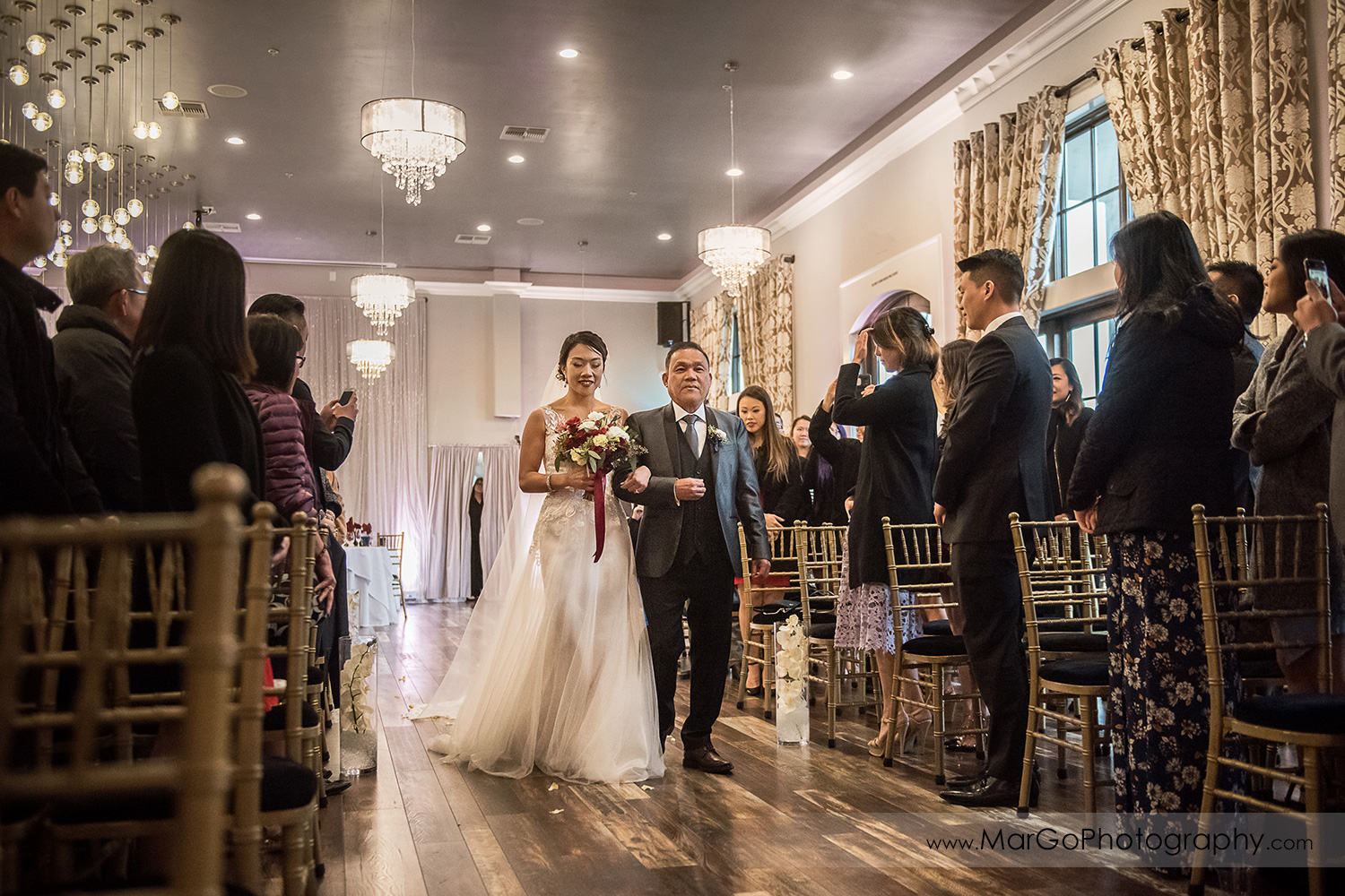 bride waling down the aisle during wedding ceremony at Sunol's Casa Bella