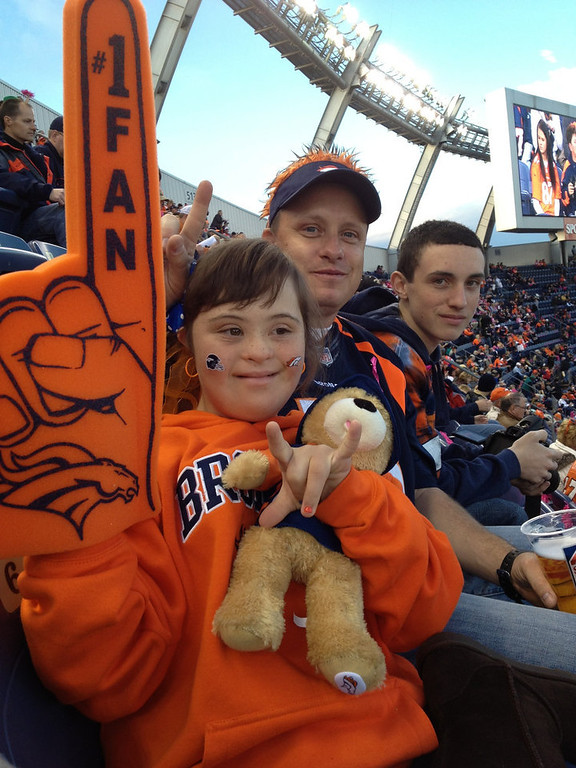 . Broncos vs Saints game Oct. 28th. 2012. My 13 yr old daughter Kenzie Lee has Down syndrome but that doesn\'t stop her from anything. She LOVES the Broncos. Also in this picture is my husband Tommy Lee & my son Chase Lee. Tiffany Lee