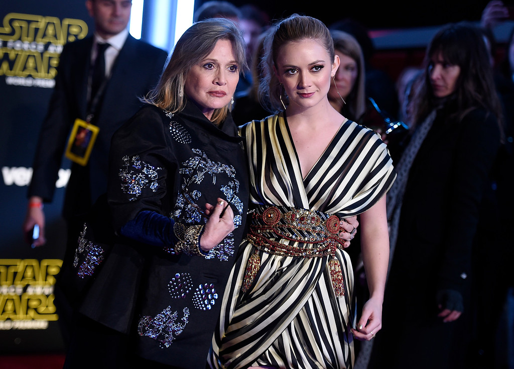 """. Carrie Fisher, left, and daughter Billie Lourd arrive at the world premiere of \""""Star Wars: The Force Awakens\"""" at the TCL Chinese Theatre on Monday, Dec. 14, 2015, in Los Angeles. (Photo by Jordan Strauss/Invision/AP)"""