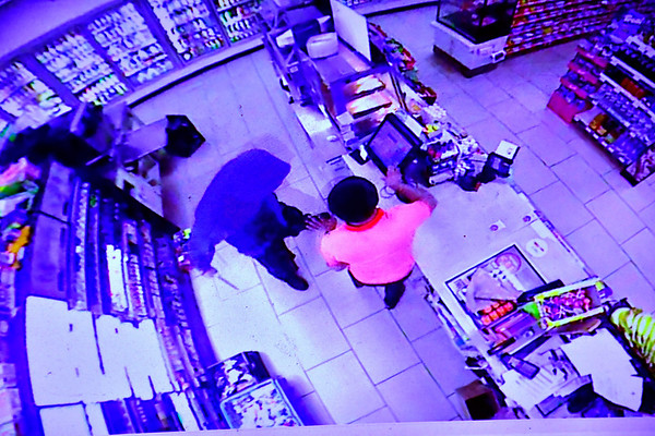 10/31/2019 Mike Orazzi | StaffrStill images from an armed robbery by a man wielding a knife at the 7-Eleven on Riverside Avenue in Bristol early Wednesday morning.