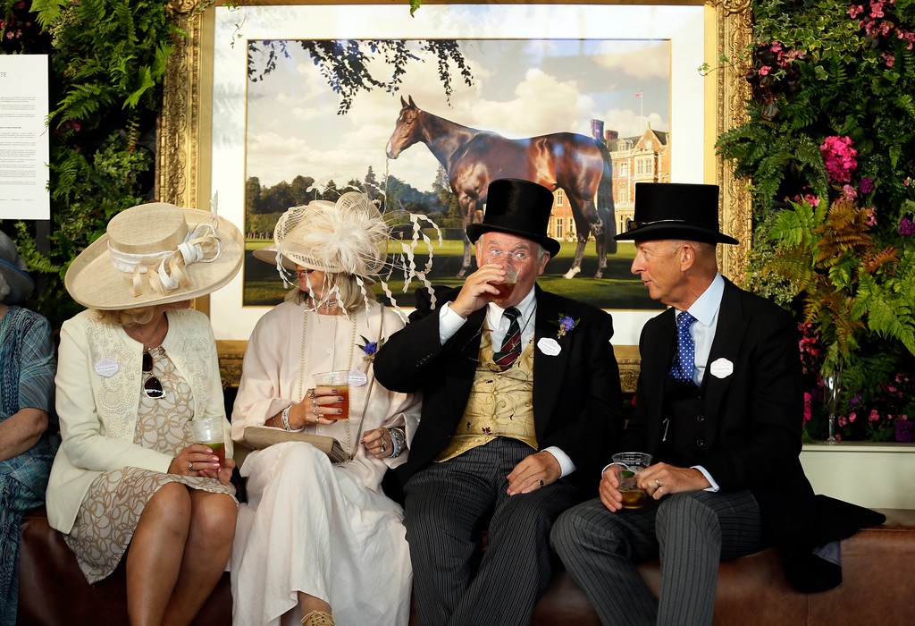 . Racegoers enjoy a drink on the first day of the Royal Ascot horse race meeting in Ascot, England, Tuesday, June 19, 2018. (AP Photo/Tim Ireland)