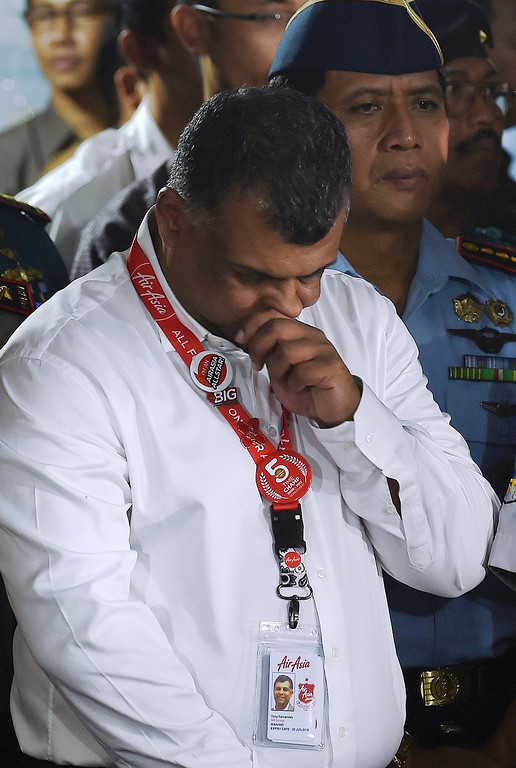 . AirAsia CEO Tony Fernandes gestures as Indonesian President Joko Widodo (not in picture) addresses the media after meeting with family members of passengers onboard the missing Malaysian air carrier AirAsia flight QZ8501, at the Juanda International Airport in Surabaya on December 30, 2014. The hunt for a missing AirAsia passenger plane appeared over on December 30 as wreckage and bodies were spotted at sea off Indonesia, prompting raw scenes of emotion from sobbing relatives of the 162 people aboard.  MANAN VATSYAYANA/AFP/Getty Images