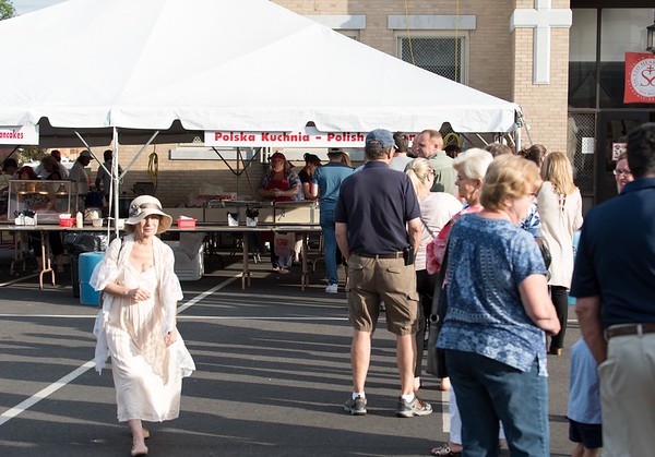 06/21/18 Wesley Bunnell | Staff Visitors wait in line for polish platters on the first night of the Sacred Heart Parish Festival on Friday evening.