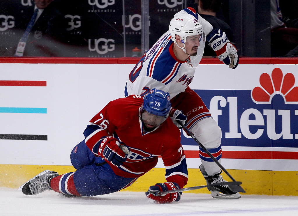 . MONTREAL, QC - MAY 17:  Chris Kreider #20 of the New York Rangers checks P.K. Subban #76 of the Montreal Canadiens in the second period in Game One of the Eastern Conference Finals of the 2014 NHL Stanley Cup Playoffs at the Bell Centre on May 17, 2014 in Montreal, Canada.  (Photo by Bruce Bennett/Getty Images)