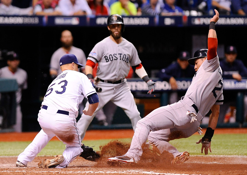 . Jacoby Ellsbury #2 of the Boston Red Sox scores on a wild pitch in the fourth inning as Alex Cobb #53 of the Tampa Bay Rays tries to cover home plate during Game Three of the American League Division Series at Tropicana Field on October 7, 2013 in St Petersburg, Florida.  (Photo by Brian Blanco/Getty Images)