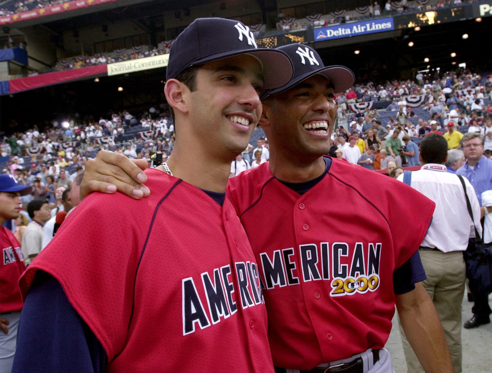 . New York Yankees\' Jorge Posada, left, and Mariano Rivera pose druing practice for the All-Star game Monday, July 10, 200O, in Atlanta. (AP Photo/Ed Reinke)