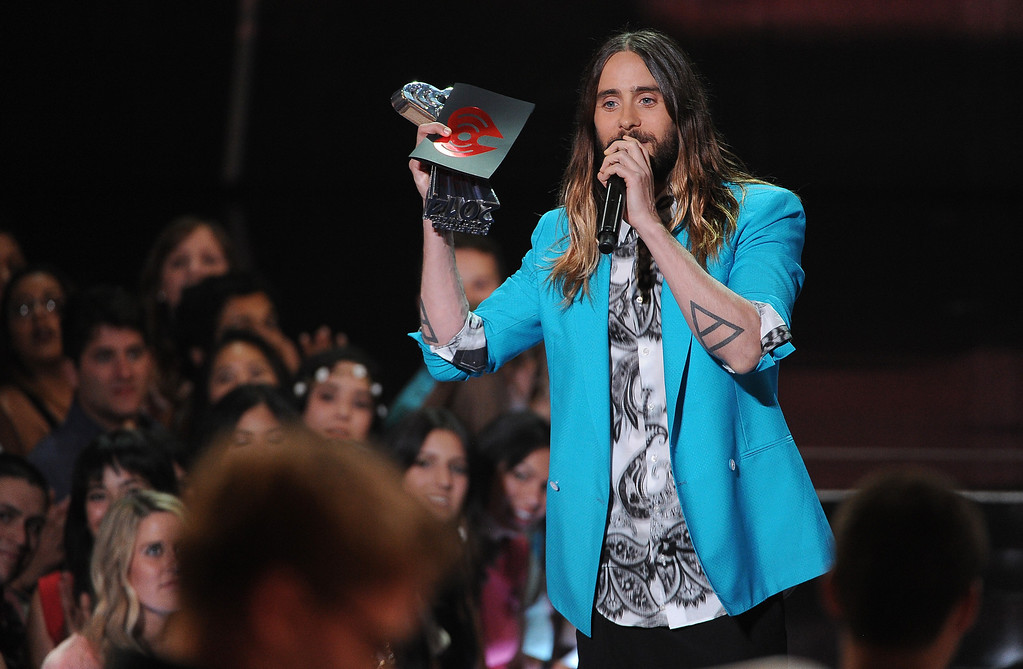 . Jared Leto presents the award for best new artist at the iHeartRadio Music Awards at the Shrine Auditorium on Thursday, May 1, 2014, in Los Angeles. (Photo by Chris Pizzello/Invision/AP)