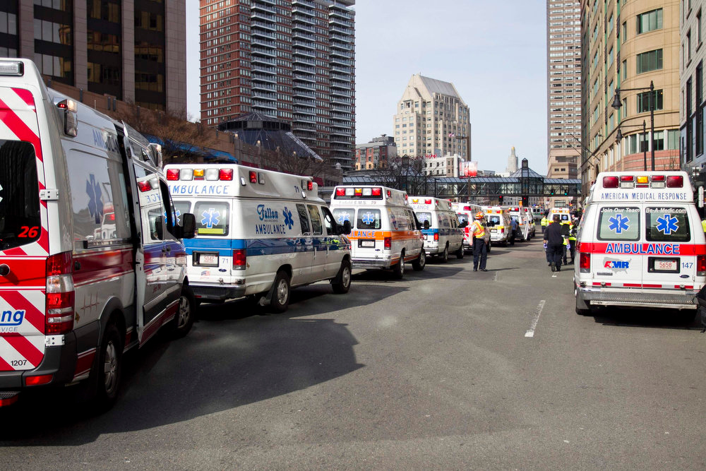 . Ambulances line the street after explosions reportedly interrupted the running of the 117th Boston Marathon in Boston, Massachusetts April 15, 2013. Two explosions hit the Boston Marathon as runners crossed the finish line on Monday, killing at least two people and injuring 23 on a day when tens of thousands of people pack the streets to watch one of the world\'s best known marathons. REUTERS/Dominick Reuter
