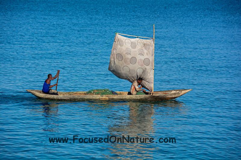Fishermen in dugout canoe
