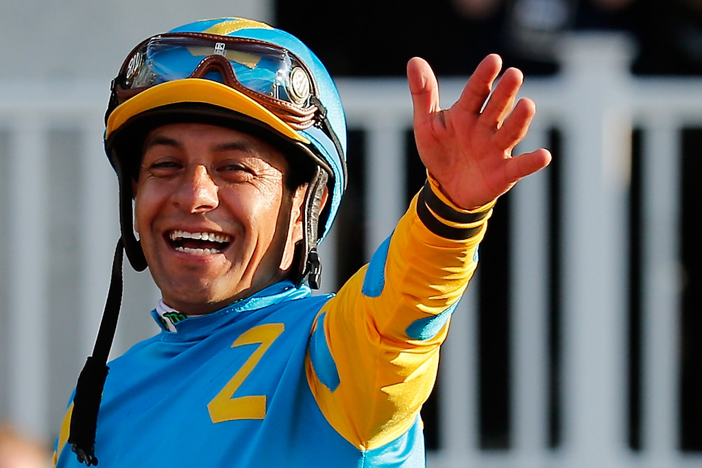 . Victor Espinoza, celebrates atop American Pharoah #5, in the winner\'s circle after winning the 147th running of the Belmont Stakes at Belmont Park on June 6, 2015 in Elmont, New York. With the wins American Pharoah becomes the first horse to win the Triple Crown in 37 years.  (Photo by Rob Carr/Getty Images)