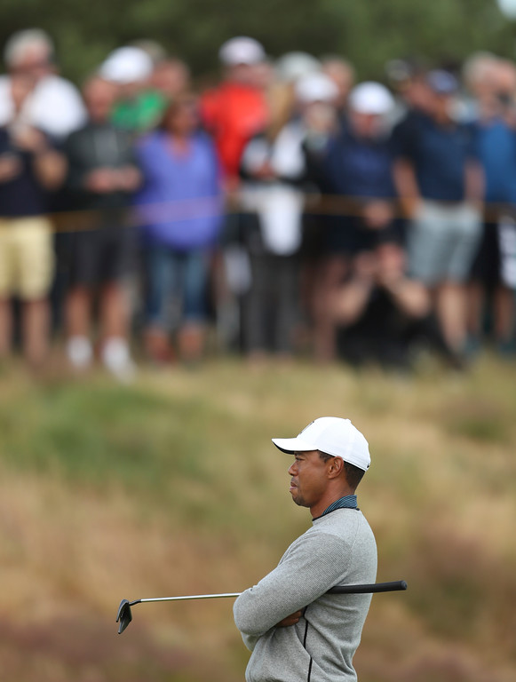 . Tiger Woods of the US waits to play on the 12th green during a practice round ahead of the British Open Golf Championship in Carnoustie, Scotland, Wednesday July 18, 2018. (AP Photo/Jon Super)