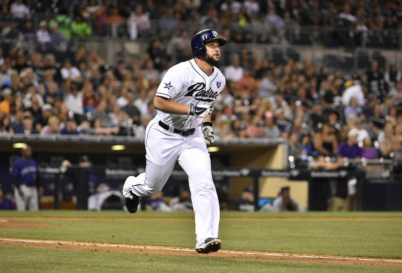 . Yonder Alonso #23 of the San Diego Padres watches the flight of his solo home run hit during the fourth inning of a baseball game against the Colorado Rockies at Petco Park August, 11, 2014 in San Diego, California.  (Photo by Denis Poroy/Getty Images)