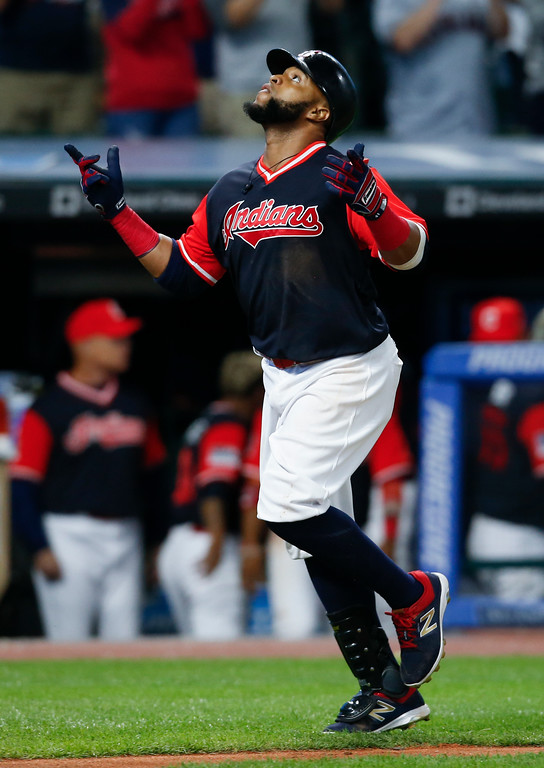 . Cleveland Indians\' Carlos Santana celebrates after hitting a solo home run off Kansas City Royals starting pitcher Jason Hammel during the seventh inning in a baseball game, Saturday, Aug. 26, 2017, in Cleveland. (AP Photo/Ron Schwane)