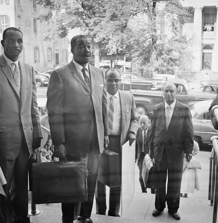 . Lawyers and witnesses participating in the Arlington county school integration hearing arrive at the Federal Courthouse in Alexandria, Va., September 3, 1950. In foreground left to right: Frank D. Reeves, NAACP attorney, Thomas H. Henderson, Dean of Virginia University. (AP Photo)