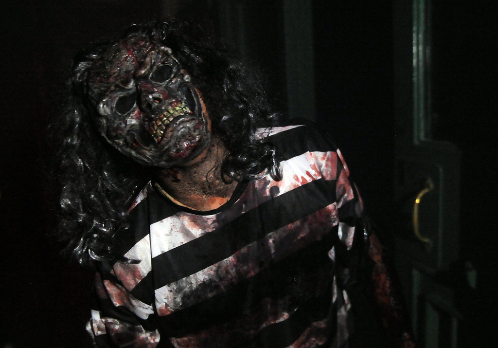 . A zombie walks through the halls of the jail during the annual Open House and Haunted Jail at Norwalk Sheriff Station in Norwalk, Calif., on Saturday, Oct. 19, 2013. Sheriff department\'s Aero Bureau, SWAT, Arson Explosives Detail, Recruitment unit, along with the L.A. County Fire Department, U.S. Army with a military vehicle, CHP, and the Sheriff\'s Department dragster were on display.  (Keith Birmingham Pasadena Star-News)
