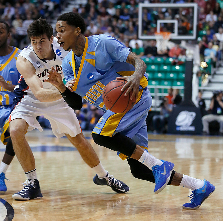 . Southern University\'s Derick Beltran, right, drives past Gonzaga\'s Drew Barham in the first half during a second-round game in the NCAA college basketball tournament in Salt Lake City, Thursday, March 21, 2013. (AP Photo/George Frey)
