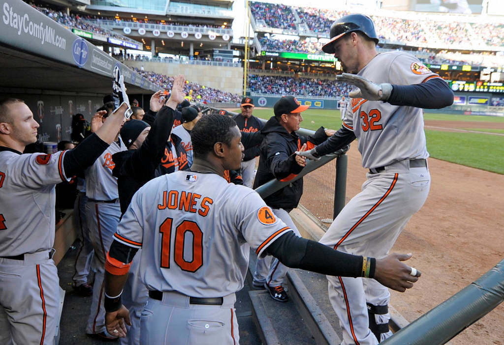 . Baltimore Orioles\' Matt Wieters, right, is greeted in the dugout after his solo home run off Minnesota Twins pitcher Vance Worley in the fourth inning. (AP Photo/Jim Mone)