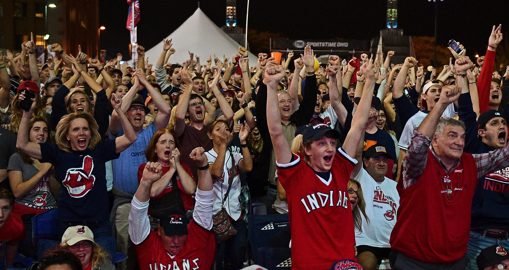. Cleveland Indians fans react during a watch party for Game 7 of the baseball World Series between the Indians and the Chicago Cubs, outside Progressive Field, Wednesday, Nov. 2, 2016, in Cleveland. (AP Photo/David Dermer)