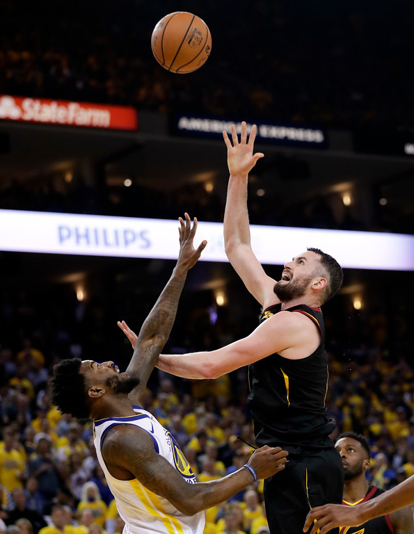 . Cleveland Cavaliers forward Kevin Love, right, shoots against Golden State Warriors forward Jordan Bell during the second half of Game 1 of basketball\'s NBA Finals in Oakland, Calif., Thursday, May 31, 2018. (AP Photo/Marcio Jose Sanchez)