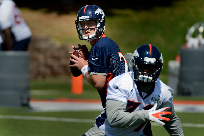 . Rookie quarterback # 2 Zac Dysert dropping back during Broncos rookie minicamp at the Broncos Dove Valley facility May 10, 2013 Centennial, Colorado. (Photo By Joe Amon/The Denver Post)