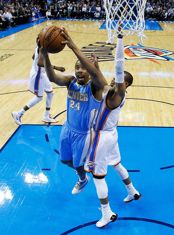 . Denver Nuggets guard Andre Miller (24) shoots in front of Oklahoma City Thunder guard Russell Westbrook (0) in the first quarter of an NBA basketball game in Oklahoma City, Tuesday, March 19, 2013. Denver won 114-104. (AP Photo/Sue Ogrocki)