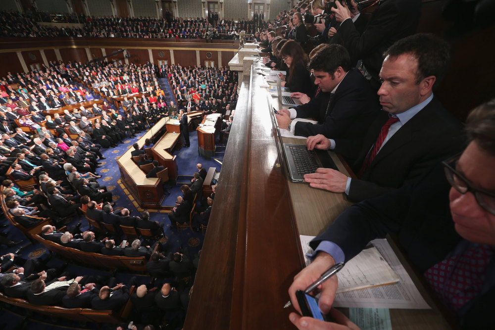 ". Reporters listen from their gallery as U.S. President Barack Obama delivers his State of the Union speech before a joint session of Congress at the U.S. Capitol February 12, 2013 in Washington, DC. Facing a divided Congress, Obama focused his speech on new initiatives designed to stimulate the U.S. economy and said, ""It�s not a bigger government we need, but a smarter government that sets priorities and invests in broad-based growth\"".  (Photo by Chip Somodevilla/Getty Images)"