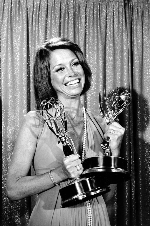 ". Mary Tyler Moore holds her Emmys at the 26th Annual Primetime Emmy Awards in Los Angeles, Ca., on May 28, 1974.  Moore won best actress of the year in a comedy series and best actress in a television series for her role in the ""Mary Tyler Moore Show.\""  (AP Photo)"