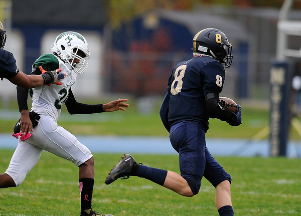 10/25/2019 Mike Orazzi | StaffrNewington High Schools Austyn Howe (8) breaks free on a kick off during Friday afternoons football game with Maloney High School in Newington. r