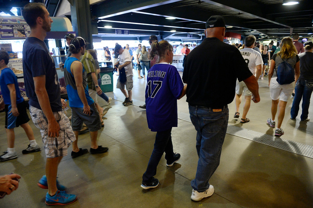 . DENVER, CO. - AUGUST 16:  Colorado Rockies fans head out of Coors Field Saturday evening, August 16, 2014 after the announcement came that the game against the Cincinnati Reds was cancelled due to a water main break along Blake St, cutting off water supply to the stadium. (Photo By Andy Cross / The Denver Post)