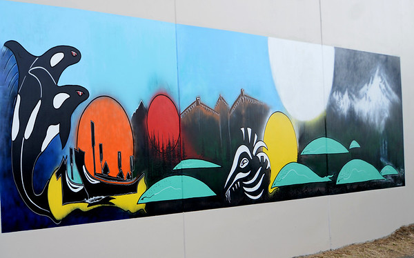 John Romero restores the Duwamish Mural