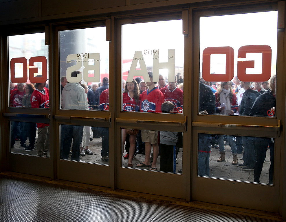 . MONTREAL, QC - MAY 17:  Montreal Canadiens fans stand outside before Game One of the Eastern Conference Finals of the 2014 NHL Stanley Cup Playoffs against the New York Rangers at the Bell Centre on May 17, 2014 in Montreal, Canada.  (Photo by Bruce Bennett/Getty Images)
