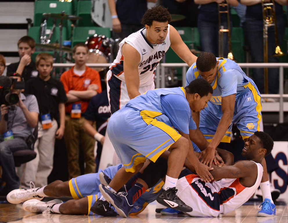 . SALT LAKE CITY, UT - MARCH 21:  Gary Bell Jr. #5 of the Gonzaga Bulldogs holds onto the ball against three Southern University Jaguars defenders during the second round of the 2013 NCAA Men\'s Basketball Tournament at EnergySolutions Arena on March 21, 2013 in Salt Lake City, Utah.  (Photo by Harry How/Getty Images)