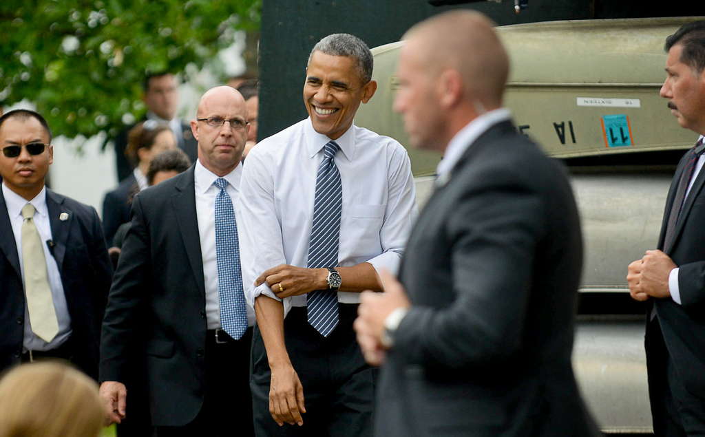 . With his Secret Service detail in tow, President Barack Obama arrives to deliver his speech at the Lake Harriet Bandshell. (Pioneer Press: Ben Garvin)