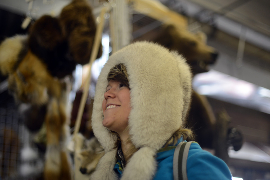 . Abigail Gutierrez, 19, fits the fur hat at the Expo Hall of 2013 National Western Stock Show on Tuesday. Denver. CO, January 15, 2013.  Hyoung Chang, The Denver Post