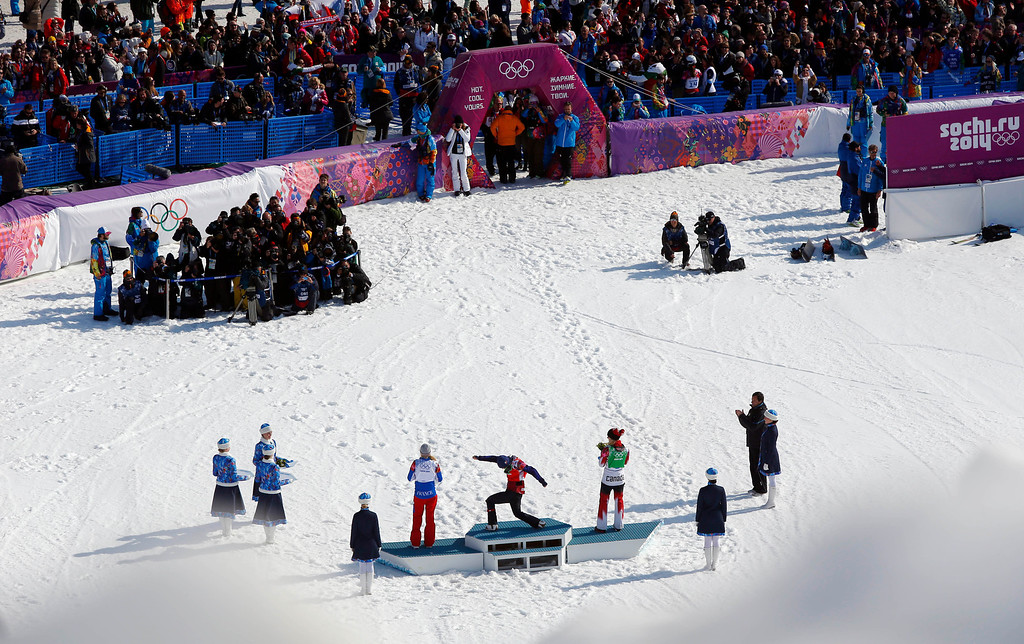 . Czech Republic\'s Eva Samkova, center, celebrates after taking the gold medal in the women\'s snowboard cross final, ahead of silver medalist Dominique Maltais of Canada, right, and bronze medalist France\'s Chloe Trespeuch at the Rosa Khutor Extreme Park, at the 2014 Winter Olympics, Sunday, Feb. 16, 2014, in Krasnaya Polyana, Russia.  (AP Photo/Sergei Grits)