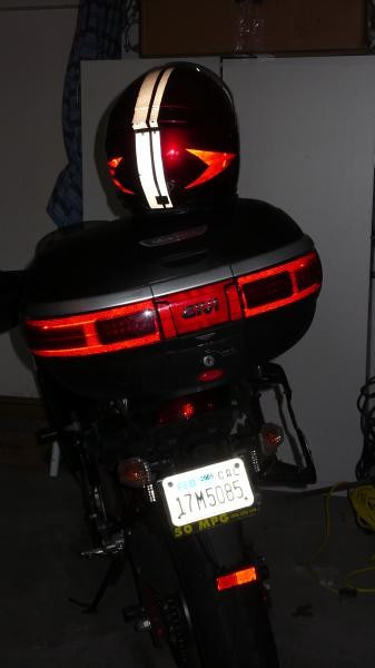 This is what the bike looks like with the lights off and the LEDs installed behind the red lenses of the case. The camera flash shows how the reflective material I installed last year outlines where the LEDs are. I took the side cases off to make my commute easier.
