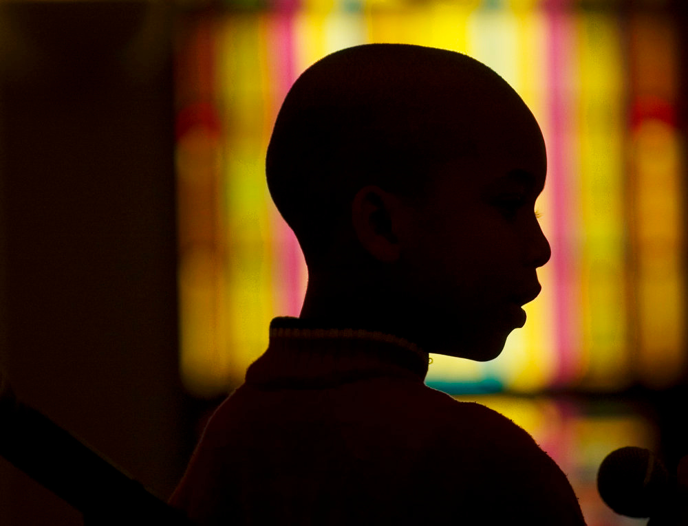 Description of . Kyle Kelly, 7, reads from the Bible during a Black History Month commemoration at the Second Baptist Church in Moorestown, N.J. (AP Photo/Courier-Post, Jose F. Moreno)