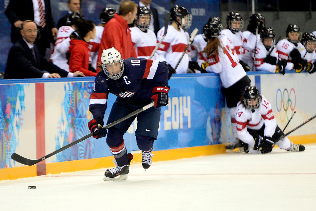 . Meghan Duggan (10) of the U.S.A. brings the puck into the open ice against Switzerland during the second period of action at the Shayba Arena. Sochi 2014 Winter Olympics on Monday, February 10, 2014. (Photo by AAron Ontiveroz/The Denver Post)
