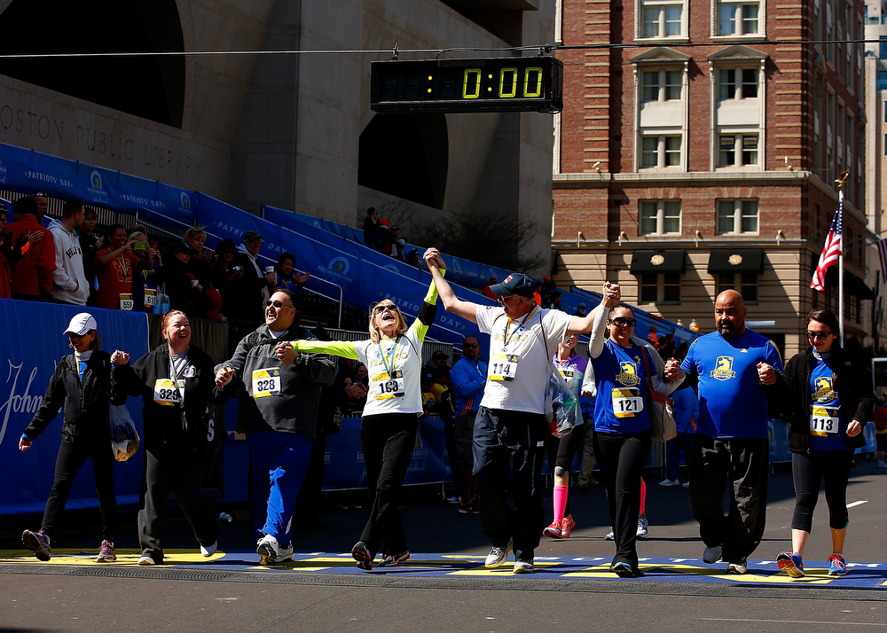 . Beth and Michael Bourgault react after crossing the Boston Marathon finish line with friends and family during the B.A.A. Tribute Run on April 19, 2014 in Boston, Massachusetts.  (Photo by Jared Wickerham/Getty Images)