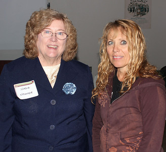 """Kim Keehn of Deadwood (on right in photo) has been named to the Board of Directors of the Lawrence County Historical Society.  """"Kim brings a love of history and great enthusiasm to our group,"""" said LCHS president Norma Kraemer (at left) in welcoming Kim to the Board.  Keehn grew up in Montana and Wyoming and first came to Deadwood in the 1970's.  """"I got a job working for Don Clowser at his Bella Union location; he took me under his wing and increased my love of history tenfold,"""" said Keehn, who's held several jobs dealing with history, museum work, narrating the Boot Hill Tours, and working on the Chinatown archaeological dig. She's also pursued family history since 1991.  """"It's my favorite thing to do, and today I have 28,040 people in my tree.  I have a family deeply rooted in American history – lines starting in the 1600's. You never know what amazing things you'll uncover at the turn of a page or the click of a mouse!"""" ~~~~~ Click Historical Marker to return to our web site. ~~~~"""