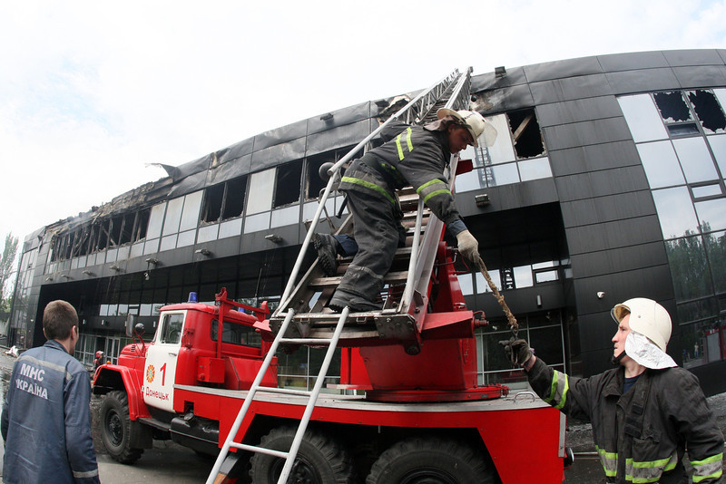 . Firemen work on the damaged Druzhba Hockey Arena in the eastern Ukrainian city of Donetsk, burned by unknown armed men, after they extinguished the fire on May 27, 2014. A fierce battle erupted Monday for control of the main airport in rebel-held eastern Ukraine in a dramatic escalation of the conflict. (Alexander KHUDOTEPLY/AFP/Getty Images)