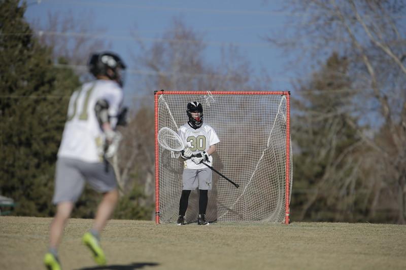 JPM0164-JPM0164-Jonathan first HS lacrosse game March 9th.jpg