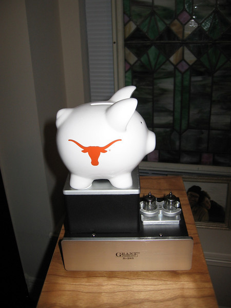 I live in Texas, and one requirement of any Texas system is that it must sound Texan, which is the opposite of wimpy. My Grant Fidelity tube processor helps by itself, but when I stacked the UT piggie atop the transformer housing I heard an enhanced midbass that reminds me of a fat Texas girl I once saw doing the two-step at a C&W dance hall.