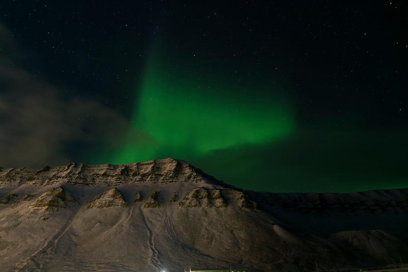 Aurora Borealis over Longyearbyen's night sky