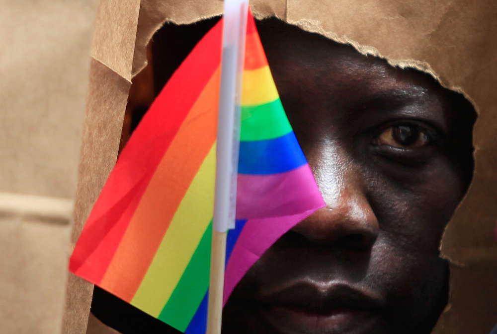 . An asylum seeker from Uganda covers his face with a paper bag in order to protect his identity as he marches with the LGBT Asylum Support Task Force during the Gay Pride Parade in Boston, Massachusetts June 8, 2013. REUTERS/Jessica Rinaldi