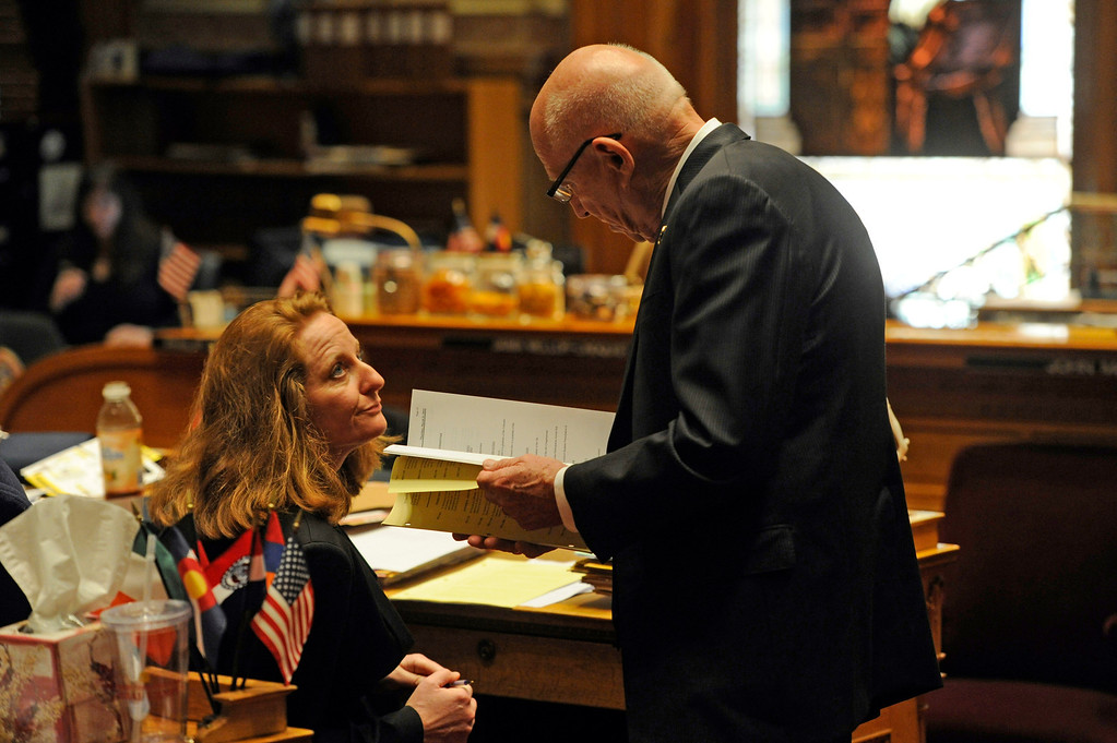 . DENVER, CO. - MARCH 8: Senator Rollie Heath, right, meets with Senator Morgan Carroll on the Senate floor. Debate begins on the Senate floor at the state capitol on various gun bills before the state legislature. (Photo By Kathryn Scott Osler/The Denver Post)