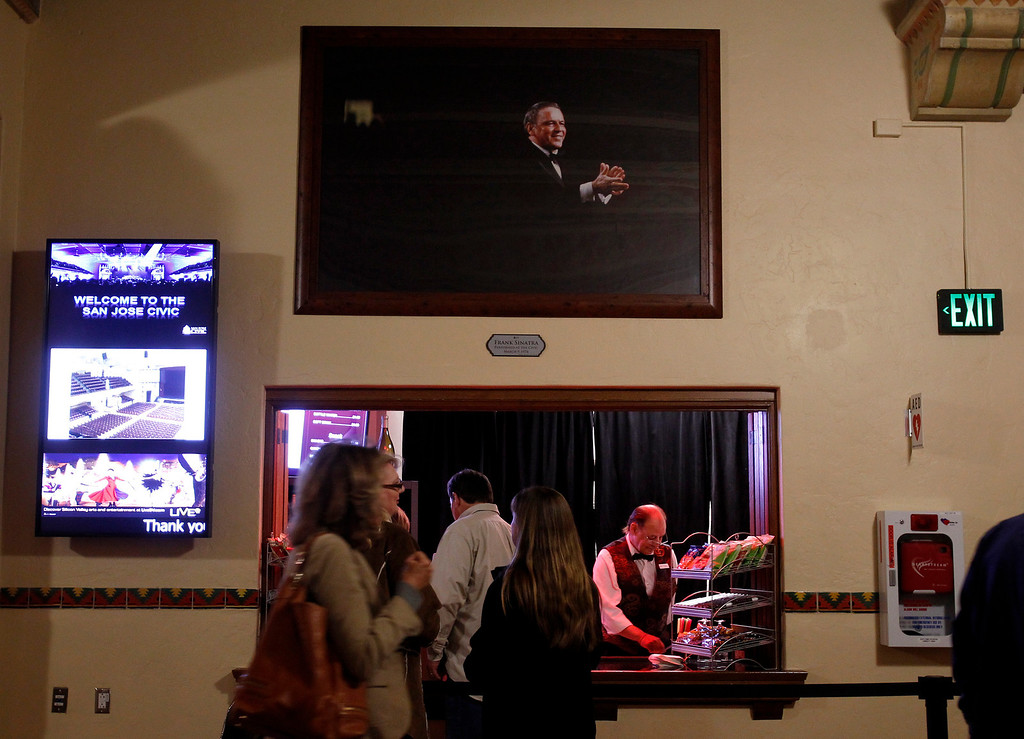 . A photograph of Frank Sinatra who performed at the San Jose Civic in 1974 hangs above a concession stand in the main lobby of the San Jose Civic before Jackson Browne performed in downtown San Jose, Calif. on Tuesday, Jan. 22, 2013.  This specific photograph is not necessarily his performance at the Civic but a representation of that performance.  (Nhat V. Meyer/Staff)