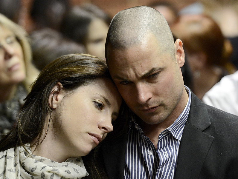 . Carl Pistorius (R) and Aimee Pistorius (L) attend the appearance of their brother South African Olympic sprinter Oscar Pistorius on February 19, 2013 at the Magistrate Court in Pretoria. Pistorius battled to secure bail as he appeared on charges of murdering his model girlfriend Reeva Steenkamp on February 14, Valentine\'s Day. South African prosecutors will argue that Pistorius is guilty of premeditated murder in Steenkamp\'s death, a charge which could carry a life sentence.  STEPHANE DE SAKUTIN/AFP/Getty Images